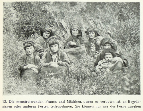 A group of menstruating women watching a funeral in Khevsureti in 1927